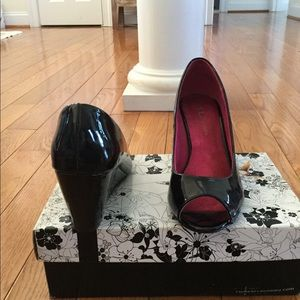 Gently used, black Nolita Patent Leather wedges